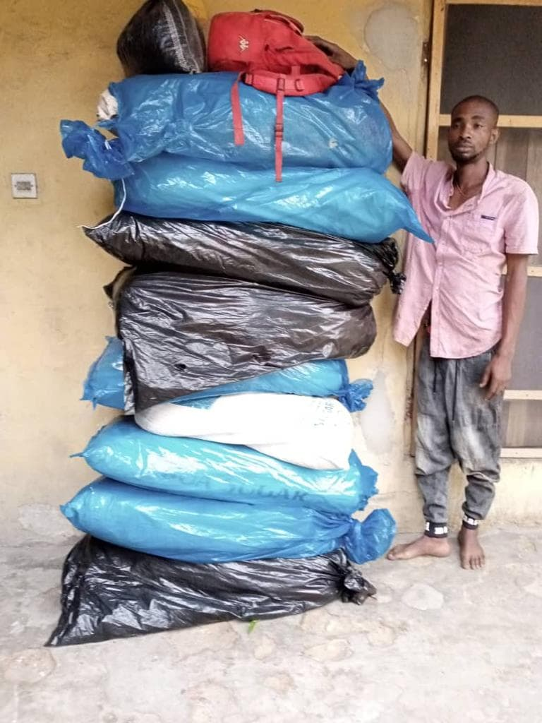 Chibuike Apolos with the 10 bags of the illicit drugs