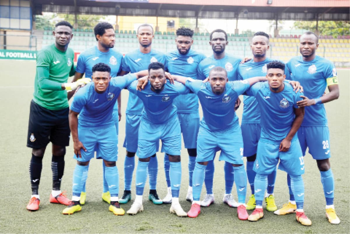 Line-up of Enyimba FC before their match against Sunshine Stars of Akure at the Agege Township stadium in Lagos